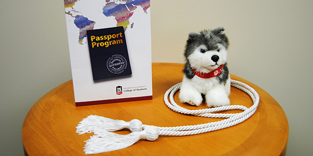Passport Scholar white cord and certificate